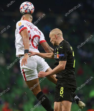 Sevilla's Diego Carlos, left, and Krasnodar's Yury Gazinsky head the ball during the UEFA Champions League, group E, soccer match, between Krasnodar and Sevilla at the Krasnodar Stadium in Krasnodar, Russia