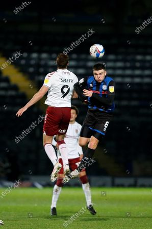 Aaron Morley of Rochdale  (8) heads the ball under challenge from Northampton Town Forward Harry Smith (9) during the EFL Sky Bet League 1 match between Rochdale and Northampton Town at the Crown Oil Arena, Rochdale