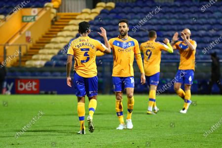 James Perch (14) of Mansfield Town and Malvind Benning (3) of Mansfield Town during the EFL Sky Bet League 2 match between Mansfield Town and Harrogate Town at the One Call Stadium, Mansfield