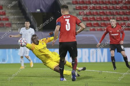 Stock Image of Rennes' goalkeeper Alfred Gomis saves a ball during the Champions League, group E soccer match between Rennes and Chelsea at the Roazhon Park stadium in Rennes, France