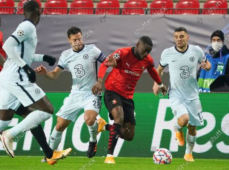 James Lea Siliki (2-R) of Rennes in action against Cesar Azpilicueta (2-L) of Chelsea during the UEFA Champions League group E soccer match between Stade Rennes and Chelsea FC in Rennes, France, 24 November 2020.