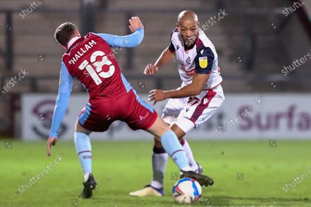 Jordan Hallam ,Alex Baptiste  during the EFL Sky Bet League 2 match between Scunthorpe United and Bolton Wanderers at the Sands Venue Stadium, Scunthorpe