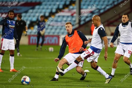 Stock Photo of Eoin Doyle ,Alex Baptiste during the EFL Sky Bet League 2 match between Scunthorpe United and Bolton Wanderers at the Sands Venue Stadium, Scunthorpe