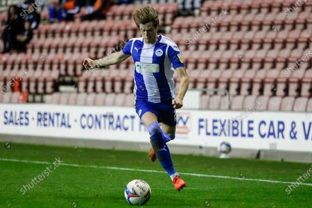 Wigan Athletic FC Defender Tom Pearce (3) on the attack during the EFL Sky Bet League 1 match between Wigan Athletic and Bristol Rovers at the DW Stadium, Wigan