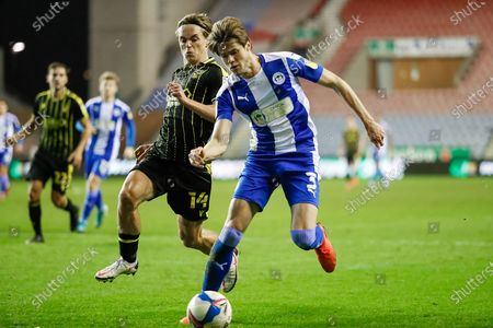 Wigan Athletic FC Defender Tom Pearce (3) and Bristol Rovers FC Midfielder Luke McCormick (14) on loan from Chelsea FC compete for the ball during the EFL Sky Bet League 1 match between Wigan Athletic and Bristol Rovers at the DW Stadium, Wigan