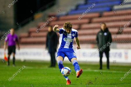Wigan Athletic FC Defender Tom Pearce (3) crosses the ball from the wing during the EFL Sky Bet League 1 match between Wigan Athletic and Bristol Rovers at the DW Stadium, Wigan