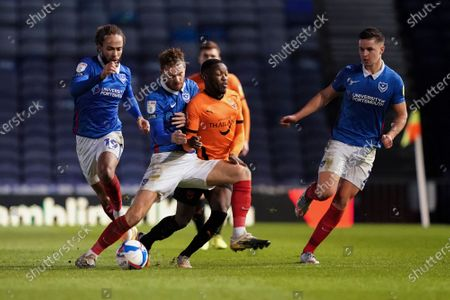Tom Naylor of Portsmouth tackles Olamide Shodipo of Oxford United during the EFL Sky Bet League 1 match between Portsmouth and Oxford United at Fratton Park, Portsmouth