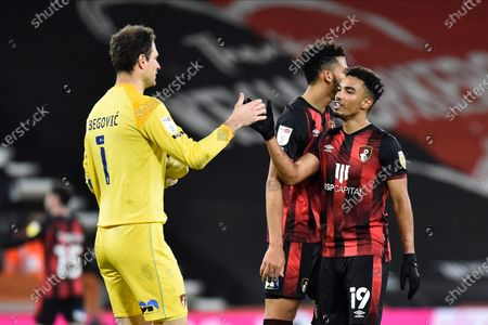 Junior Stanislas (19) of AFC Bournemouth celebrates the 2-0 win with Asmir Begovic (1) of AFC Bournemouth at full time during the EFL Sky Bet Championship match between Bournemouth and Nottingham Forest at the Vitality Stadium, Bournemouth