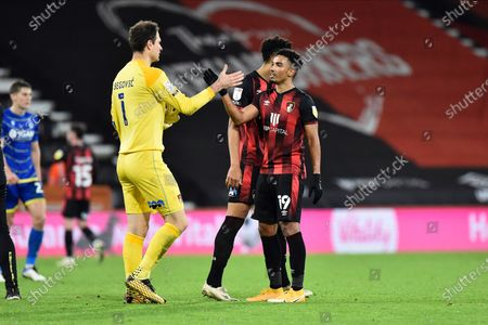 Stock Photo of Junior Stanislas (19) of AFC Bournemouth celebrates the 2-0 win with Asmir Begovic (1) of AFC Bournemouth at full time during the EFL Sky Bet Championship match between Bournemouth and Nottingham Forest at the Vitality Stadium, Bournemouth