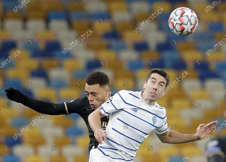 Carlos de Pena (R) of Dynamo Kiev in action against Sergino Dest (L) of FC Barcelona during the UEFA Champions League group G soccer match between Dynamo Kiev and FC Barcelona in Kiev, Ukraine, 24 November 2020.