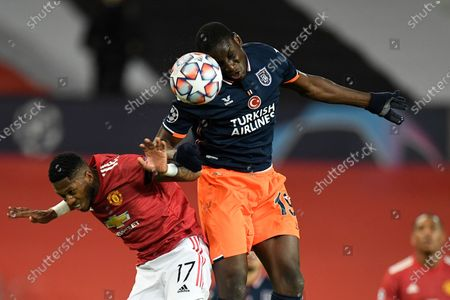 Fred of Manchester United (L) and Demba Ba of Istanbul Basaksehir (R) in action during the UEFA Champions League group H soccer match between Manchester United and Istanbul Basaksehir in Manchester, Britain, 24 November 2020.