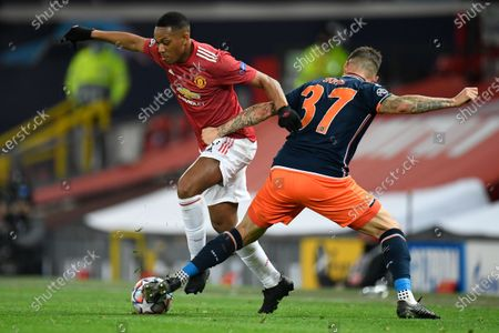 Stock Picture of Anthony Martial of Manchester United (L) and Martin Skrtel of Istanbul Basaksehir (R) in action during the UEFA Champions League group H soccer match between Manchester United and Istanbul Basaksehir in Manchester, Britain, 24 November 2020.