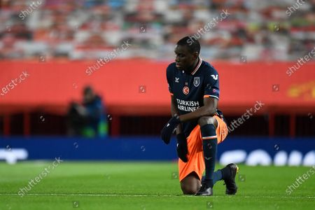 Demba Ba of Istanbul Basaksehir takes a knee to support the Black Lives Matter movement ahead of the UEFA Champions League group H soccer match between Manchester United and Istanbul Basaksehir in Manchester, Britain, 24 November 2020.
