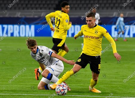 Brugge's Charles De Ketelaere, left, tries to stop Dortmund's Thorgan Hazard, right, during the Champions League group F soccer match between Borussia Dortmund and Club Brugge in Dortmund, Germany