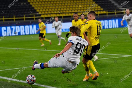 Brugge's Charles De Ketelaere, left, blocks Dortmund's Thorgan Hazard, right, during the Champions League group F soccer match between Borussia Dortmund and Club Brugge in Dortmund, Germany