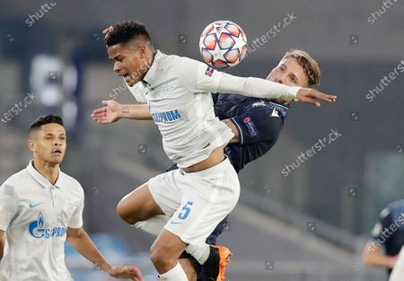 Zenit's Wilmar Barrios, left, jumps for the ball with Lazio's Ciro Immobile during a Champions League group F soccer match between Lazio and Zenit Saint Petersburg, at Rome's Olympic Stadium