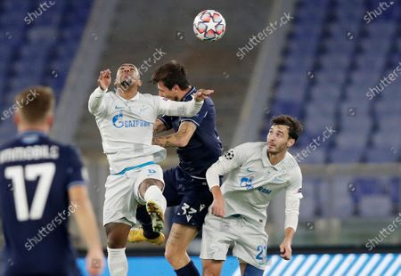 Stock Image of Lazio's Francesco Acerbi, center, jumps for the ball with Zenit's Malcom, left, and Zenit's Aleksandr Yerokhin during a Champions League group F soccer match between Lazio and Zenit Saint Petersburg, at Rome's Olympic Stadium