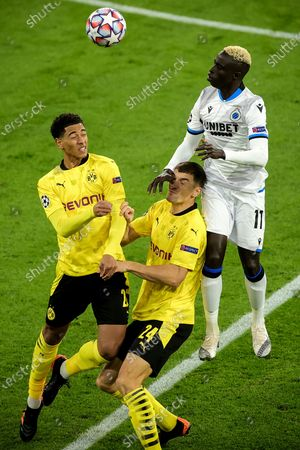 Dortmund's Jude Bellingham (L) and Thomas Meunier (C) in action against Brugge's Krepin Diatta (R) during the UEFA Champions League group F soccer match between Borussia Dortmund and Club Brugge in Dortmund, Germany, 24 November 2020.