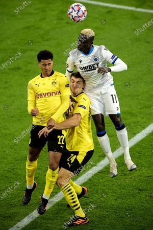 Stock Picture of Dortmund's Jude Bellingham (L) and Thomas Meunier (C) in action against Brugge's Krepin Diatta (R) during the UEFA Champions League group F soccer match between Borussia Dortmund and Club Brugge in Dortmund, Germany, 24 November 2020.