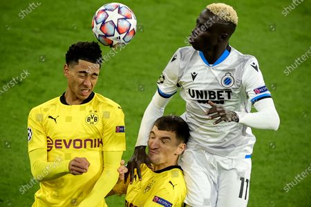 Stock Photo of Dortmund's Jude Bellingham (L) and Thomas Meunier (C) in action against Brugge's Krepin Diatta (R) during the UEFA Champions League group F soccer match between Borussia Dortmund and Club Brugge in Dortmund, Germany, 24 November 2020.