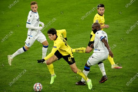 Dortmund's Giovanni Reyna (2-L) in action against Brugge's Eder Balanta (R) during the UEFA Champions League group F soccer match between Borussia Dortmund and Club Brugge in Dortmund, Germany, 24 November 2020.