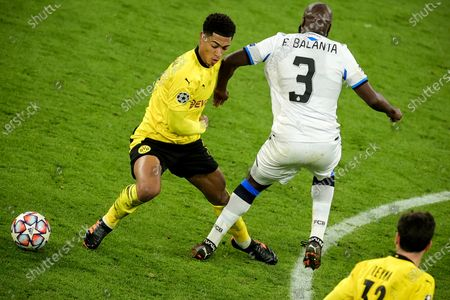 Dortmund's Jude Bellingham (L) in action against Brugge's Eder Balanta (R) during the UEFA Champions League group F soccer match between Borussia Dortmund and Club Brugge in Dortmund, Germany, 24 November 2020.