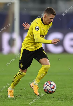 Stock Photo of Thorgan Hazard of Dortmund runs with the ball during the UEFA Champions League Group F stage match between Borussia Dortmund and Club Brugge KV at Signal Iduna Park in Dortmund, Germany, 24 November 2020.
