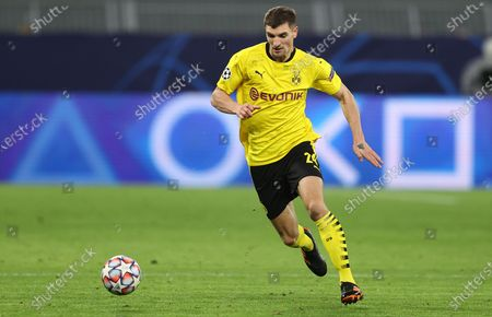 Stock Image of Thomas Meunier of Dortmund runs with the ball during the UEFA Champions League Group F stage match between Borussia Dortmund and Club Brugge KV at Signal Iduna Park in Dortmund, Germany, 24 November 2020.