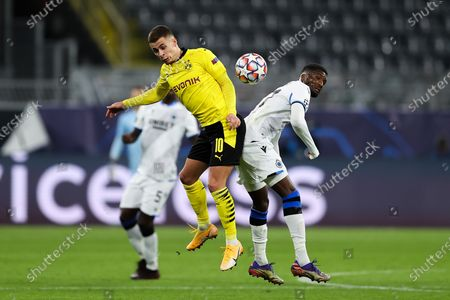 Thorgan Hazard of Borussia Dortmund (L) and Clinton Mata of Club Brugge KV during the UEFA Champions League Group F stage match between Borussia Dortmund and Club Brugge KV at Signal Iduna Park in Dortmund, Germany,24 November 2020.