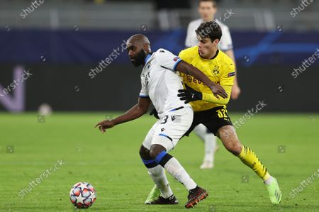 Stock Photo of Eder Alvarez Balanta of Club Brugge and Giovanni Reyna of Borussia Dortmund (R) battle for the ball UEFA Champions League Group F stage match between Borussia Dortmund and Club Brugge KV at Signal Iduna Park in Dortmund, Germany,24 November 2020.