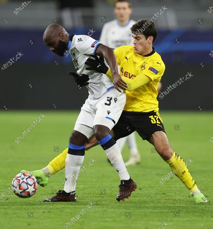 Eder Alvarez Balanta of Club Brugge and Giovanni Reyna of Borussia Dortmund (R) battle for the ball UEFA Champions League Group F stage match between Borussia Dortmund and Club Brugge KV at Signal Iduna Park in Dortmund, Germany,24 November 2020.