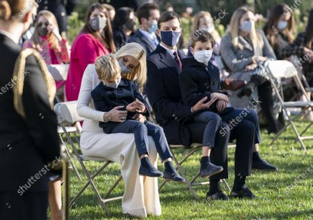 Ivanka Trump and Jared Kushner hold their children Joseph and Theodore, as they attend the National Thanksgiving Turkey pardoning at the White House. President Donald Trump pardoned Corn the National Thanksgiving Turkey.
