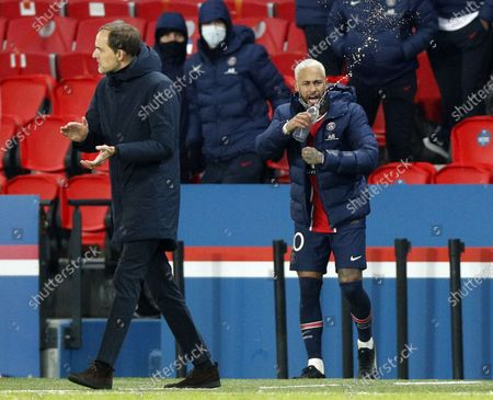 Neymar Jr (R) and Head coach Thomas Tuchel (L) of PSG celebrate their victory against Leipzig during the UEFA Champions League Group H soccer match between Paris Saint Germain (PSG) and RB Leipzig in Paris, France, 24 November 2020.