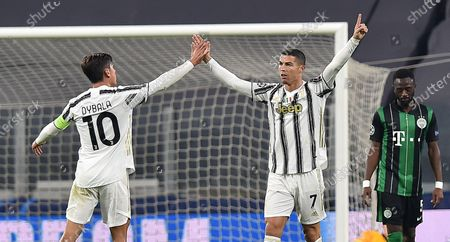 Juventus' Cristiano Ronaldo (C) celebrates with teammate Paulo Dybala after scoring his team's first goal during the UEFA Champions League group G soccer match Juventus FC vs Ferencvaros at the Allianz stadium in Turin, Italy, 24 November 2020.