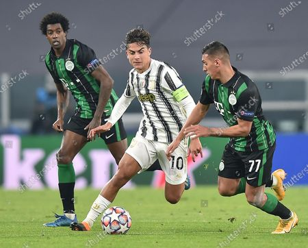 Juventus' Paulo Dybala (C) and Ferencvaros's Myrto Uzuni (R) in action during the UEFA Champions League group G soccer match Juventus FC vs Ferencvaros at the Allianz stadium in Turin, Italy, 24 November 2020.