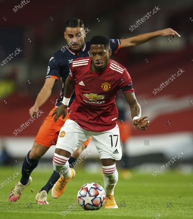 Manchester United's Fred fights for the ball against Basaksehir's Aziz Behich during the Champions League Group H soccer match between Manchester United and Istanbul Basaksehir at Old Trafford in Manchester, England