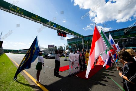 Albert Park, Melbourne, Australia. Sunday 20 March 2016. The drivers line up for the National Anthem sung by Samantha Jade. World Copyright: Zak Mauger/LAT Photographic