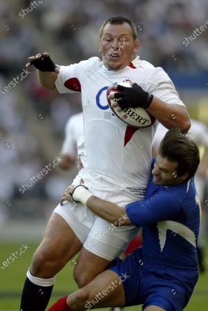 Stock Picture of FILE PHOTO- 6th September 2003: STEVE THOMPSON is tackled by Christophe Dominici, ENGLAND 45 v France 14, Ivestec Challenge, World Cup warm up match, Twickenham.