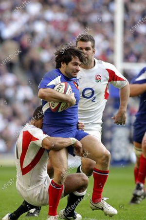 Stock Image of FILE PHOTO- 11 March 2007: French wing Christophe Dominici is tackled by Jason Robinson during the RBS six Nations International between England and France, played at Twickenham. England won the game 26 - 18