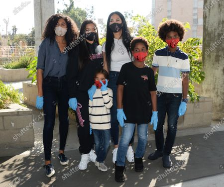 Stock Picture of Kimora Lee Simmons, Ming Lee Simmons, Aoki Lee Simmons, Kenzo Lee Hounsou, Gary Lee Leissner and Wolfe Lee Leissner serve a Thanksgiving feast to residents of Skid Row Housing Trust's Star Apartments