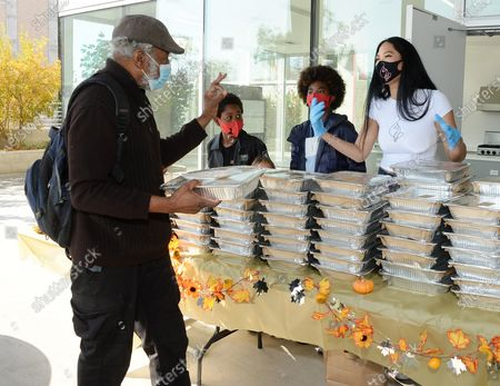 Kimora Lee Simmons serves a Thanksgiving feast to residents of Skid Row Housing Trust's Star Apartments