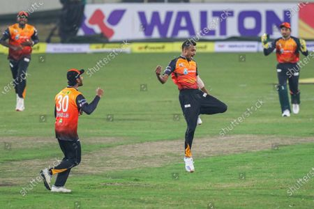 Gemcon Khulna cricket players Shafiul Islam (R) and Mohammad Mahmudullah (L) celebrate after the dismissal during the Bangabandhu T20 Cup 2020 between Fortune Barishal and Gemcon Khulna at the Sher-e-Bangla National Cricket Stadium