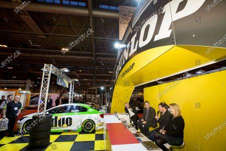Autosport International Exhibition.  National Exhibition Centre, Birmingham, UK. Thursday 14 January 2016.  Paul O'Neill, David Addison and Louise Goodman at the Dunlop stand. World Copyright: Sam Bloxham/LAT Photographic.