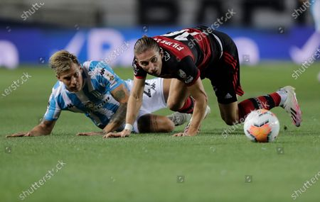 Filipe Luis of Brazil's Flamengo, right, and Gaston Reniero of Argentina's Racing Club battle for the ball during a Copa Libertadores soccer match in Buenos Aires, Argentina