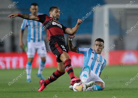 Giorgian Arrascaeta of Brazil's Flamengo, left, and Leonel Miranda of Argentina's Racing Club battle for the ball during a Copa Libertadores soccer match in Buenos Aires, Argentina