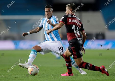 Leonel Miranda of Argentina's Racing Club, left, and Giorgian Arrascaeta of Brazil's Flamengo battle for the ball during a Copa Libertadores soccer match in Buenos Aires, Argentina
