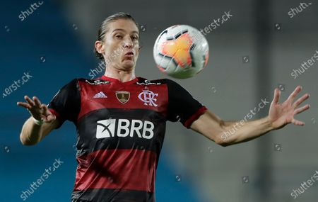 Filipe Luis of Brazil's Flamengo controls the ball during a Copa Libertadores soccer match against Argentina's Racing Club in Buenos Aires, Argentina