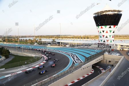 Yas Marina Circuit, Abu Dhabi, United Arab Emirates. Sunday 29 November 2015. Pastor Maldonado, Lotus E23 Mercedes and Fernando Alonso, McLaren MP4-30 Honda colide at the start of the race. World Copyright: Jed Leicester/LAT Photographic