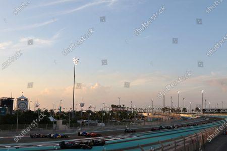 Yas Marina Circuit, Abu Dhabi, United Arab Emirates. Sunday 29 November 2015. Fernando Alonso, McLaren MP4-30 Honda, and Pastor Maldonado, Lotus E23 Mercedes, tangle round the first corner. World Copyright: Will Taylor-Medhurst/LAT Photographic