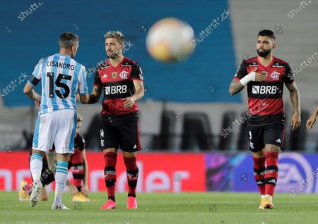 Racing's Lisandro Lopez (L) talks with Giorgian De Arrascaeta (C) of Flamengo, next to Gabriel Barbosa (R) of Flamengo, before the start of the Copa Libertadores match between Racing of Argentina and Brazilian Flamengo, at the Presidente Peron stadium, in the city of Avellaneda, in the province of Buenos Aires, Argentina, 24 November 2020.